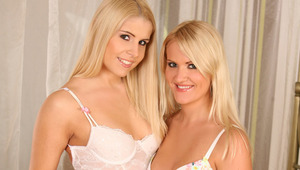 Rikki and Andrea G - Andrea (bra and panties) and Rikki are making out in bed.  They undress each other from their lingerie suck each others nipples.  Then Andrea lies back and Rikki starts eating and fingering her pussy. Then Andrea licks Rikki from behi