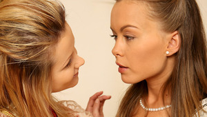 Zoe and Mya - Auburn haired beauty Mya and heavenly blonde Zoe are sitting at an antique table in the bedroom, then they stand up to compare the silky material of their Victorian, hoop dresses. They start to caress each other's bodies through the sil