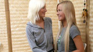 Nichol and Larissa - Luscious blondes Larissa, wearing a mini, and Nichol, in jeans, kiss each other lovingly in the kitchen, then hurriedly take off their shirts to fondle and suck each other's firm breasts and puffy nipples. They strip completely,