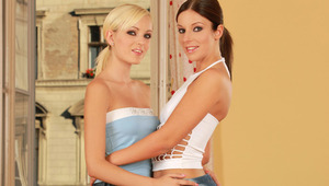 Debbie and Bianka - Dazzling blonde Bianka and brunette hottie Debbie make out on the living room couch, then pull off their tops to kiss and fondle one anothers' beautiful, ample breasts. They help each other off with their clothes and panties, then