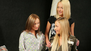Marisa, Ingrid and Larissa - Fresh faced sweeties Ingrid, blonde hair and a black shirt, Larissa, blonde with zip up jacket, and Marisa, multi colored hair, make out and fondle one another in bed, then strip off their clothes to rub and lick each other&#0