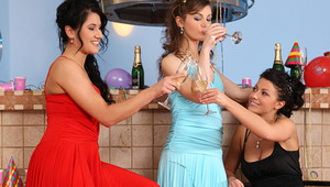 Hailee, Kay and Marion - ravishing teens Kay, turquoise dress, Marion, red dress and Hailee, ebony dress, toast with champagne and play with balloons at a new years eve party, then they embrace and kiss passionately. They help each other off with their dr