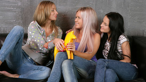 Cristal, Bea and Lora - Fresh faced nymphs Bea, auburn hair, Cristal, blonde with pink highlights, and Lora, dark hair, play with a wooden horse on a sofa, then kiss passionately and strip off their shirts. They fondle and suck one another's firm bre
