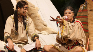 Devin and Klara - Luscious vixens Devin, darker hair, and Klara, brown hair, sit outside the teepee smoking a peace pipe, then they strip off their Indian costumes to fondle and suck each other's firm tits and perky nipples. Devin goes down on a spre