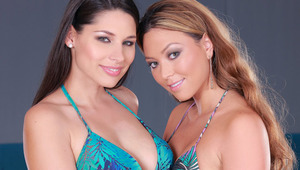 Natali and Zafira - Zafira (dark hair) and Natali make out in their bikinis by an indoor pool.  The girls kiss and then Natali removes Zafira's bikini top and sucks her large breasts.  Then Zafira removes Natali's top and sucks on her long, hard