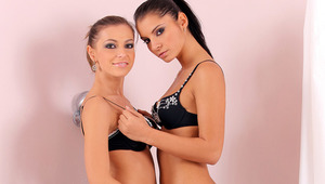 Nevena and Lucile - Sultry vixens Lucile, black hair, and Nevena, lighter hair, kiss passionately in the shower, then take of their black bras to rub and suck each other's firm melons and hard nipples. They peel off their undies, turn on the shower,