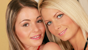 Maddy and Zara - Sultry teens Maddy, blonde, and Zara, multi colored hair, kiss and caress lovingly on a sofa, then strip off their dresses to fondle and suck each other's large breasts and areolas. They take off their panties, Zara fingers Maddy and