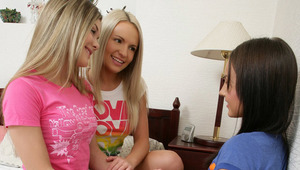 Ingrid, Ivanka and Hilaire - Sensual sweeties Hilaire, brunette, Ingrid, yellow-haired with a white top, and Ivanka, pink shirt, make out and fondle each other in bed, then they strip off Ivanka's shirt and knead and blow her small tits. They help Hi