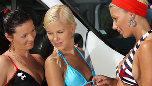Hailee, Lila and Mischelle - Captivating cuties Hailee, blonde hair and red headband, Lila, blonde and Mischelle, black hair, get out of a van, spread a blanket on the driveway and start to kiss and caress passionately. They take off their tops, fondle an