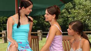 Kari, Caprice and Susan - Adorable nymphs Caprice, checkered dress, Kari, pink top, and Susan, aqua top, kiss lovingly outdoors at a picnic table, then take off their tops to caress and suckle each other's firm boobies and pink nipples. They help eac