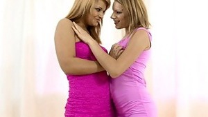 Lana and Bernice - Luscious teens Lana in a dark pink dress and Bernice in a light pink dress make out passionately and hike up their dresses to fondle each others' hot butts in the living room, then they pulls down the top of their dresses to suck o