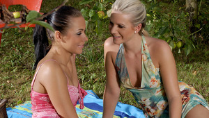 Devin and Sharon - Sultry vixens Devin, brunette, and blonde Sharon kiss and caress each other lustily at a picnic, then strip off their clothes for some outdoor fun. They spray each other's firm tits with whipped cream, blow it off lasciviously, the