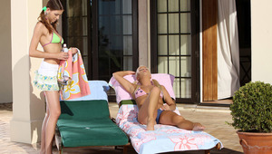 Iris and Juliette - Sultry blonde Iris is laying out on the patio, then Juliette comes over and Iris starts to rub suntan lotion over her back after she takes off her bikini top. They start to kiss, then Iris removes her top and they fondle and suck each