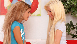 Anya and Dalia - Slender teen hotties Anya in blue top and Dalia in gray top, kiss tenderly in the living room, then they take off their tee shirts to lick and fondle 1 anothers' small tits and erect nipples. Dalia slides off Anya's skimpy, de