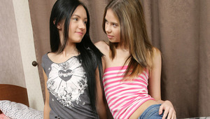 Bethany and Sasha - Adorable, skinny teens Bethany, lighter hair, and raven haired Sasha kiss and embrace passionately in bed, then Sasha helps Bethany off with her clothes and goes down on her. She fingers and blows Bethany's tight snatch, then take