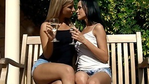 Angellina and Nadija - thin stunner Angellina and blondy sweetie Nadija toast with juice on a wooden bench on the patio, then embrace and kiss tenderly. They strip off their tops to suck and fondle one anothers' beautiful, firm boobies, then pull off
