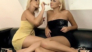 Ivana and Klaudia - Gorgeous teen Klaudia sensually strokes her stunning, blonde friend Ivana with a make up brush on a leather sofa in the living room, then they make out passionately and Ivana hikes up Klaudia's yellow dress to massage her firm ass