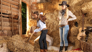 Zoe and Aneta - Busty cowgirl Zoe works hard in the hayloft when her tall, blonde friend Aneta comes and gives her a refreshing drink. They passionately kiss, then strip off their cowboy shirts and suck on each others full breasts. They rip off their boot