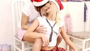 Irie and Era - blondy Irie and her adorable pal Era are in the kitchen wearing plaid minis and Santa hats when they kiss and embrace each other passionately. They strip off their clothes and finger and suck 1 another's yummy pussies, then fuck each othe