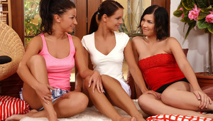 Hailee, Kari and Nena - beautiful brunettes Hailee in pink top, Kari in white, and Nena in red, make out passionately on sheepskin rugs in the living room, then they remove their tops to blow and massage one anothers' firm melons and hard nipples. Th