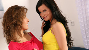 Megan and Ioana - ravishing teens Megan, yellow top and Ioana, red dress, make out passionately on the living room couch, then pull off their tops and bras to fondle and blow and fondle 1 another's firm tits and nipples. Megan takes off Ioana's