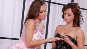 Yenny and Tess - Yenny (pink dress) and Tess hook up for lesbian sex.  The girls kiss, and then they slowly remove each others' sexy party dresses as the kiss and suck each others nipples.  Then Tess lies back in only her panties and Yenny fingers he