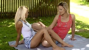 Sunshine and Jolie - Angelic blondes Jolie in red top and Sunshine in white top, embrace and kiss tenderly on a blanket in the garden, then they take off their tops to blow and fondle one anothers' beautiful titties and hard nipples. Sunshine slides