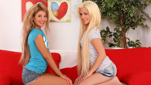 Anya and Dalia - Slender teenie hotties Anya in blue top and Dalia in gray top, kiss tenderly in the living room, then they take off their tee shirts to suck and fondle one anothers' small boobs and erect nipples. Dalia slides off Anya's skimpy,