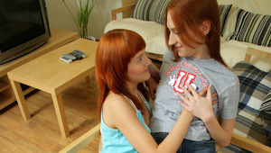 Rosanne and Philipina - Sizzling redheads Rosanne, aqua top, and Philipina make out in an armchair, then Philipina strips Rosanne's shirt, jean shorts and cotton panties off. Rosanne undresses Philipina, who spreads her legs fat in the chair and Ros