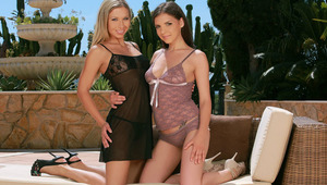 Henessy and Nadija - Brunette beauty Henessy and blonde stunner Nadija kiss passionately on the patio, then Nadija pulls down Henessy's purple camisole to fondle and suck her firm tits and erect nipples. Henessy slides down Nadija's black dress